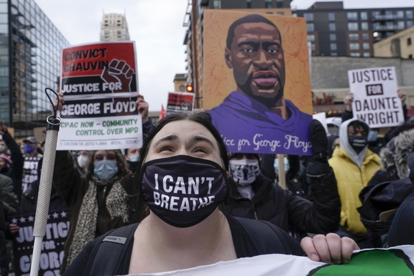 Protesters rally in Minneapolis on April 19 before a jury began deliberating in the murder trial of former police officer Derek Chauvin. Morry Gash | AP Photos