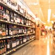 Selling alcohol in supermarkets prompts people to buy more of it, suggesting it should be sold in separate shops, like in Finland