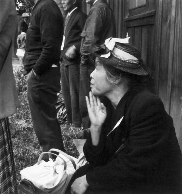 Dorothea Lange, A farm mother awaits evacuation bus. Centerville, California, 1942. Japanese internment.