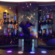 'Barney' the Swiss robot bartender can mix dozens of cocktails, tell jokes and sanitise itself