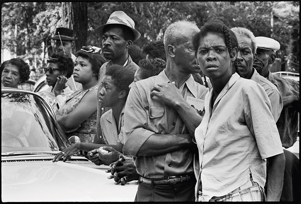 Crowds along the funeral route of the four girls murdered in the bombing of the 16th Street Baptist church, Birmingham, Alabama, September 1963 / Student Non-violent Coordinating Committee (SNCC), 1964–62. All photographs by Danny Lyon, from The Seventh Dog.
