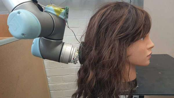 Tired of brushing your own hair? Now you can get a robot to do it for you