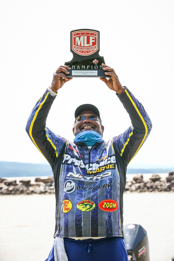 Michael Carter celebrated after winning the co-angler championship in a Major League Fishing Toyota Series tournament at Dardanelle Lake (photo by Matt Brown/Major League Fishing).