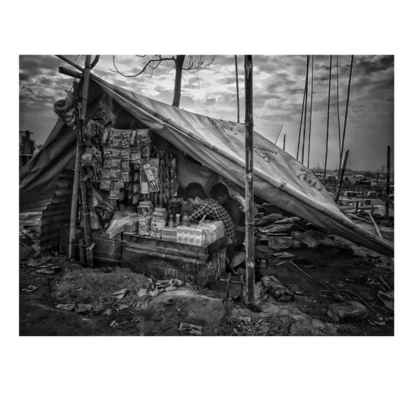 A destroyed shop keeps going.