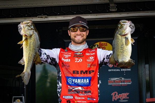 Brandon Palaniuk showed off two of the bass he used to win a Bassmaster Open tournament on the James River in Virginia. (Photo by Brenden Kanies/B.A.S.S.)