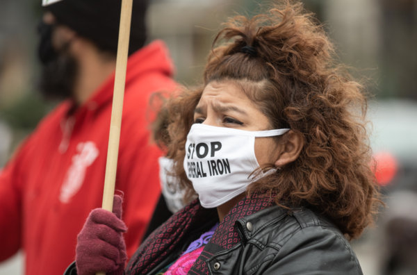 Nelly Martinez attends a November 2020 protest to demand Chicago Mayor Lori Lightfoot deny the final permit that will allow General Iron to move from Lincoln Park, a mostly white neighborhood, to the Southeast Side, which has a mostly Latino population. Pat Nabong | Sun-Times