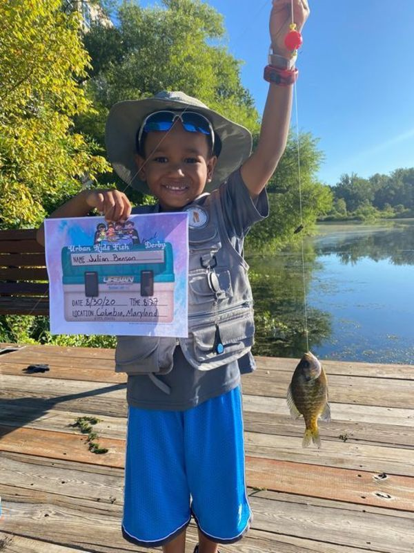 One of the kids who entered the Urban Kids Fish Virtual Fishing Derby last year showed off his catch.