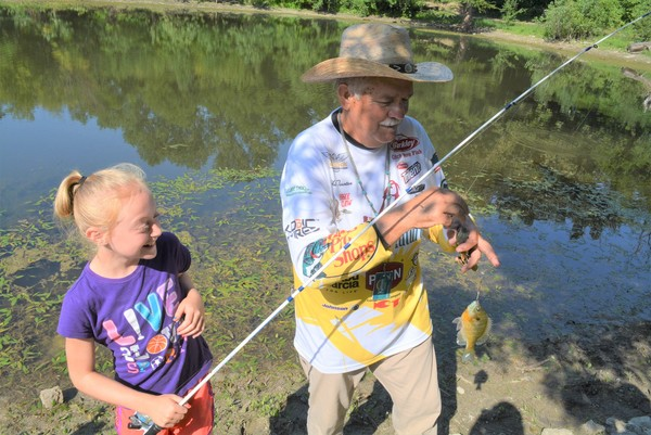 Introducing kids to fishing is a passion for volunteers such as Phil Taunton of Council Grove, Kan.