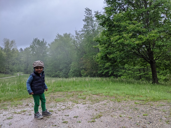 After reading his favorite book, Iman enjoys taking in Vermont's verdant countryside with his mom, loyal reader Nida.
