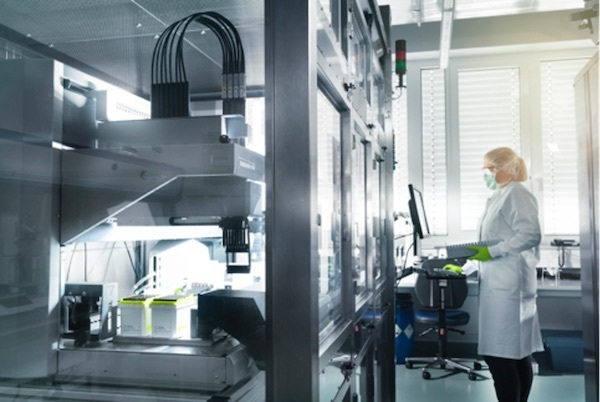 A production worker at Germany's BionTech monitoring manufacturing processes. Technology, staff and knowledge have become priced commodities during the pandemic. Photo: BioNTech SE 2021, all rights reserved.
