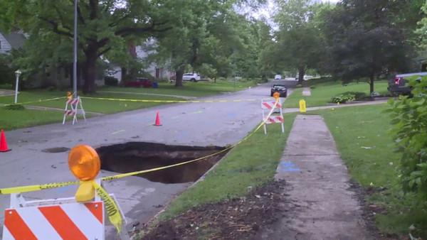 Massive sinkhole opens up in Kansas City's Brookside neighborhood after water main break