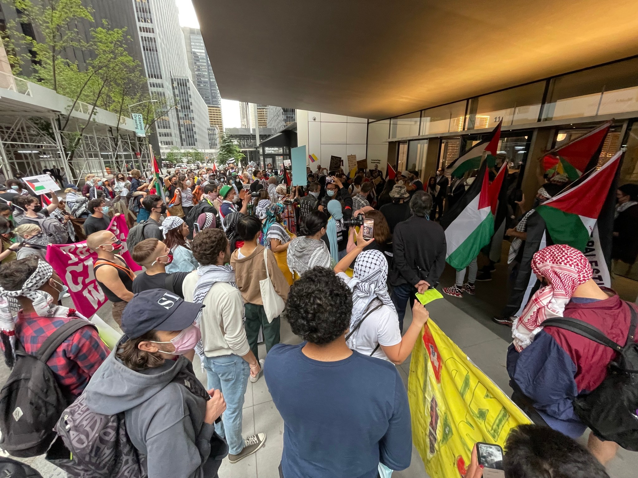 Over 200 protesters held space at MoMA's entrance on Friday, June 11