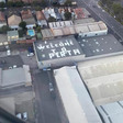 """A """"welcome to Perth"""" sign painted on a building rooftop is scaring passengers landing at Sydney airport - AIRLIVE"""