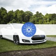 Elon Musk's Tesla Should Accept ADA, Says Cardano Founder
