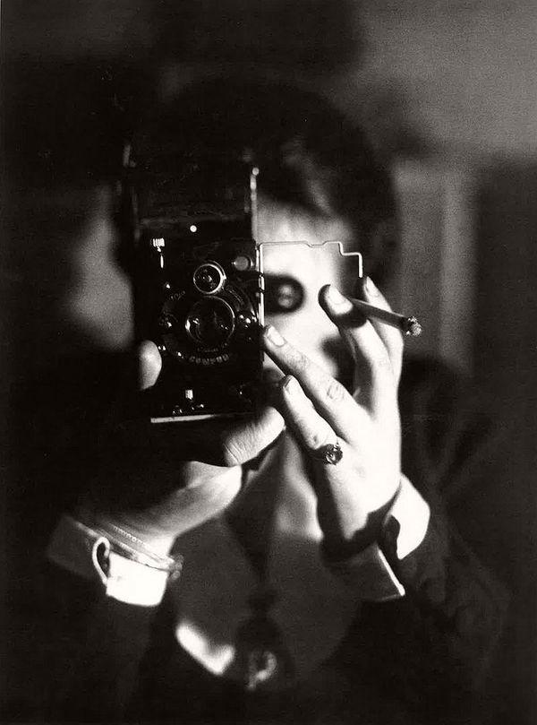 Germaine Krull, Self portrait with cigarette (Autoportrait à l'Icarette)  c. 1925.