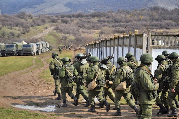 """""""Little green men"""" after the seizure of the Perevalne military base in Crimea, 9 March 2014. Photo: Anton Holoborodko (CC BY-SA 3.0)."""