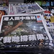 Hong Kong police arrest senior Apple Daily journalist at airport | The Guardian
