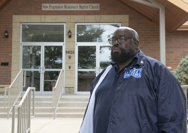 Pastor Donovan Price outside New Progressive Missionary Baptist Church last Wednesday.   Brian Rich/Sun-Times
