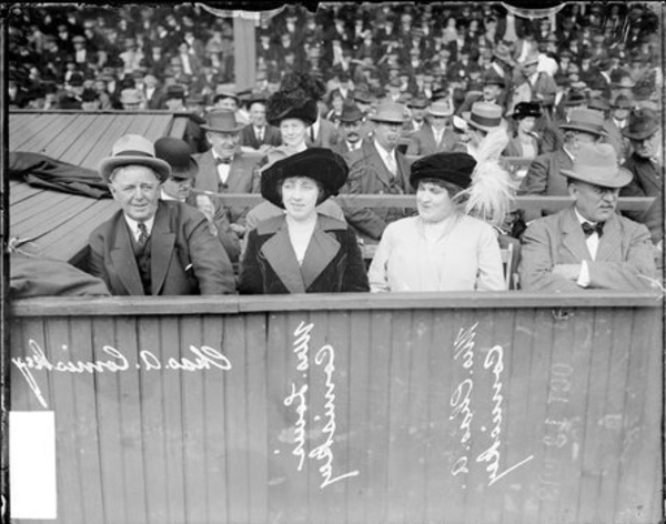 White Sox owner Charles A. Comiskey, Mrs. Louis Comiskey, and Mrs. Charles A. Comiskey sit in crowded namesake stadium at an event in 1911. From the Sun-Times archive.