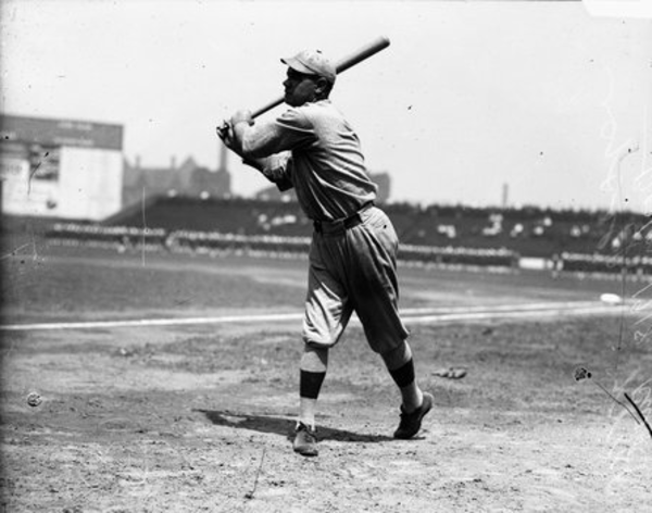 Boston Red Sox baseball player Babe Ruth follows through after swinging a baseball bat at Comiskey Park in 1918. From the Sun-Times archive.