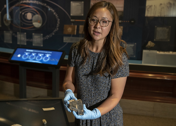 Maria Valdes, a Field Museum research scientist, holds samples of a meteorite that broke away from the asteroid Vesta.   Brian Rich/Sun-Times