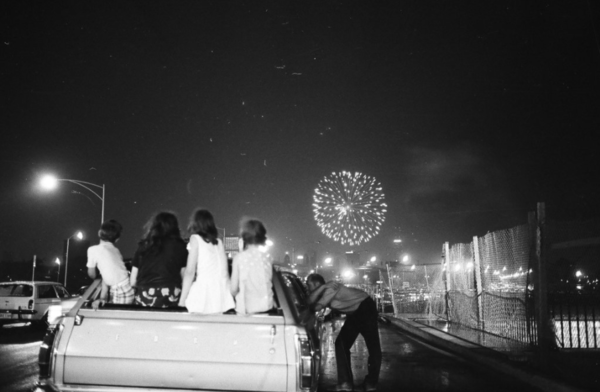 A group of teenagers and children watch the American Legion's Fourth of July fireworks display, held at Soldier Field, from a car on July 4, 1971. From the Sun-Times archive.