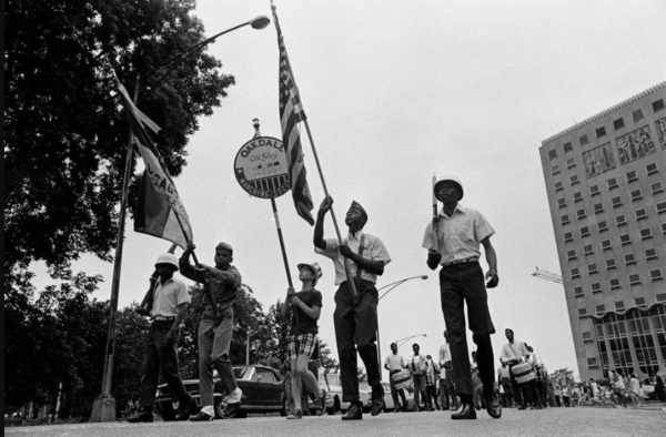 The Oakdale Old Glory Marching Society marches past Presence Saint Joseph Hospital on July 4, 1968. From the Sun-Times archive.