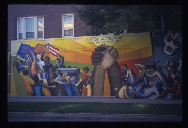 """This mural, titled """"Together We Overcome,"""" was completed by John Pitman Weber at Division and Hoyne in 1971. Restored in 2004, it's one of the oldest murals in Chicago — and the country. 