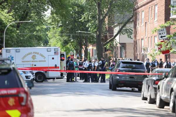 Police officers at the scene where a person was shot during a standoff with police Friday morning in the 100 block of South Kilpatrick Avenue. | Anthony Vazquez/Sun-Times