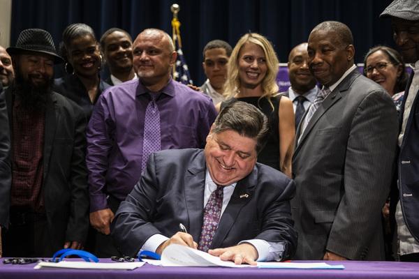 Gov. J.B. Pritzker signs a package of criminal justice reform legislation today.   Ashlee Rezin Garcia/Sun-Times