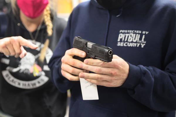 A customer checks out a gun at a suburban gun store in Illinois.   Scott Olson/Getty Images (file photo)