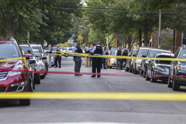 Police investigate a scene in North Lawndale on Wednesday, July 21, 2021. | Anthony Vazquez/Sun-Times