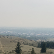 Wildfire smoke drives people in low-vaccinated areas indoors, raising outbreak fears