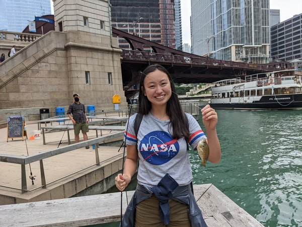 """Hannah Zhang holds a bluegill caught at """"Fishing at the Jetty"""" on the Chicago Riverwalk.   Dale Bowman/Sun-Times"""