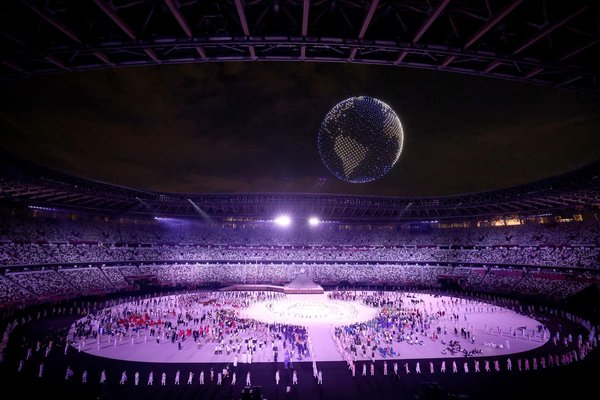 1,800 drones recreate earth in the skies over the Olympic Stadium