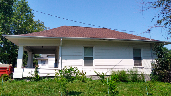 Side view of the house with new shingles