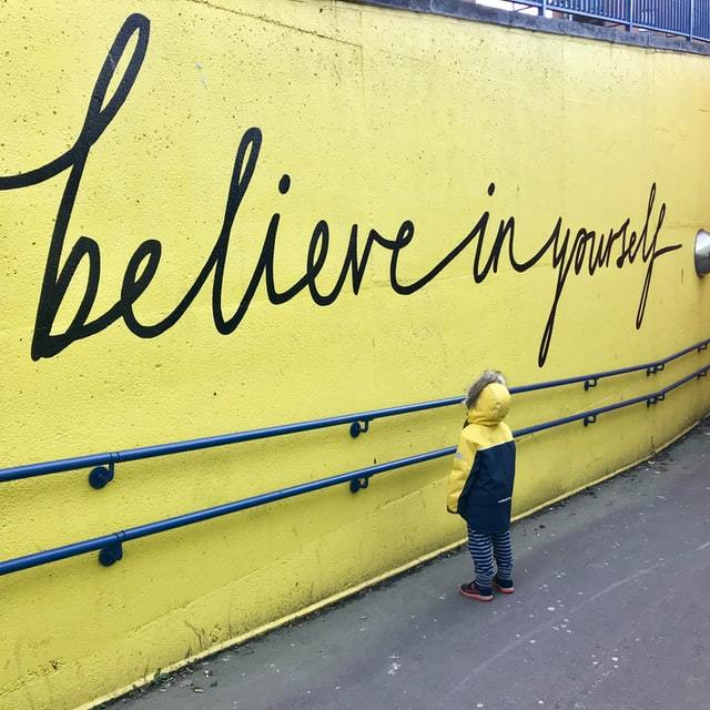 This kid's habit is to look at this wall every day.