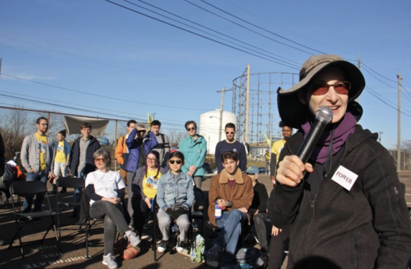 Rabbi Julie Greenberg rallies protesters during a daylong action at PES refinery in South Philadelphia. (Emma Lee/WHYY)