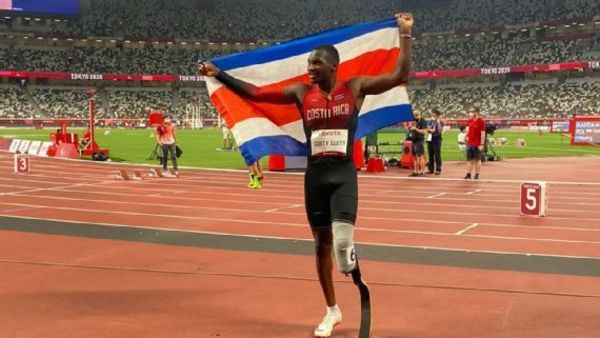 Sherman Guity wins a silver medal in the 100 meters, T64 category, in Tokyo 2020.