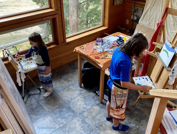 Terrill's grandchildren in their painting aprons at adapted easels in her home studio.