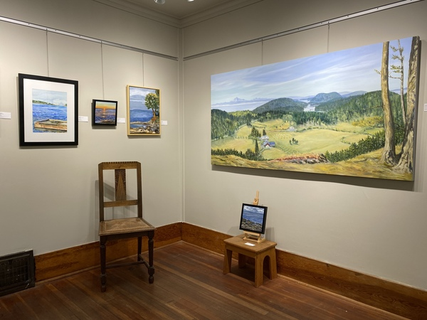On the right, large painting by Terrill Welch and small painting by Jennifer Peers.