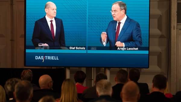 Armin Laschet oder Olaf Scholz? Wer hat Recht im Streit um Ökostrom und Finanzaufsicht?