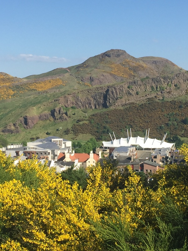 Arthur's seat seen from Edinburgh, with Scottish Parliament in the foreground