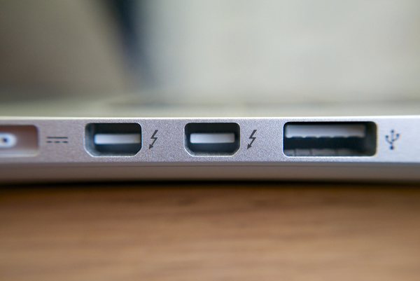 Examples of what Thunderbolt ports looked like on earlier MacBooks. Current variations use USB-C. (Kārlis Dambrāns/Flickr)