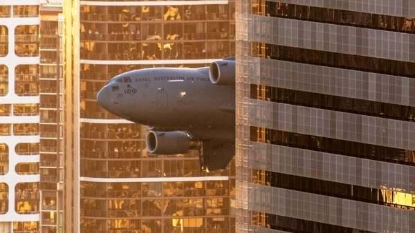 C-17 Globemaster weaves through downtown Brisbane, Australia (Mark Greemantle)
