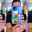 This crazy iPhone 13 case catapults hard candy at your face