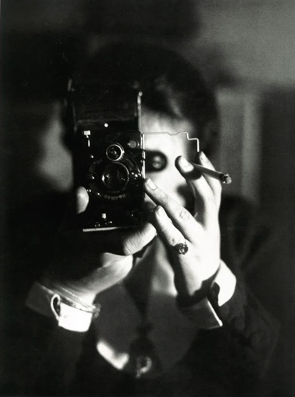 Germaine Krull, Self-Portrait with Cigarette, circa 1925. I always thought this was a cool photo. I did not know the meaning below the surface.