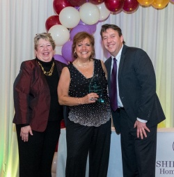Kathy Lee, Manager of the Concord office, accepts Office of the Year Award