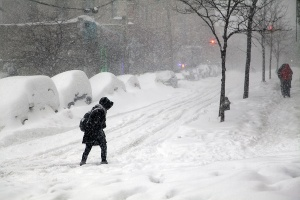 person walking through snow storm