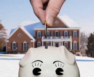 piggy bank in front of houses